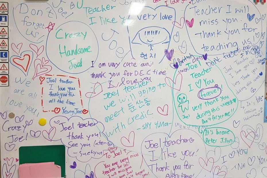 White board with lots of messages from students