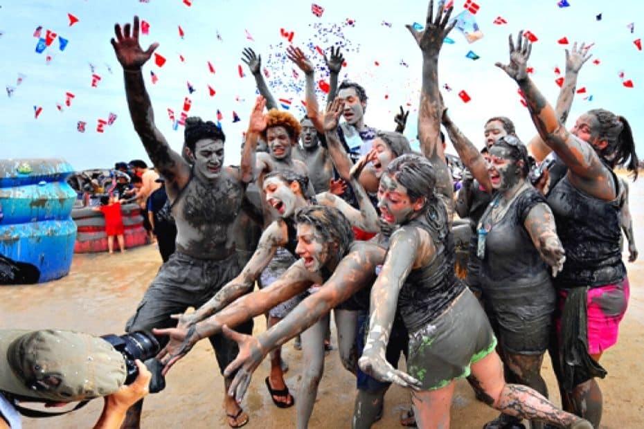 People enjoying the Boryeong Mud Festival, Korea