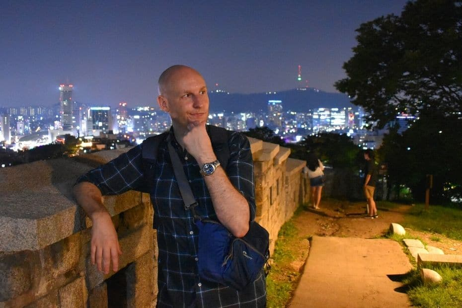 Joel standing by the Seoul Fortress Wall at night