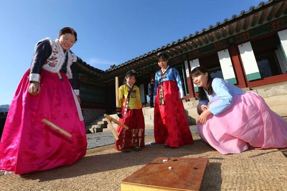 Korean family playing yut nori during a Korean holiday