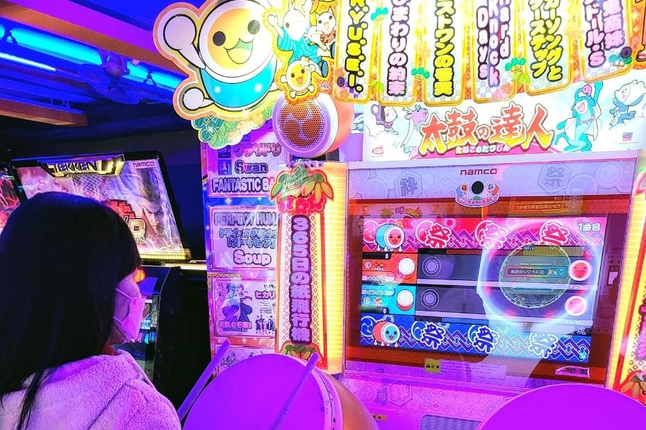 Playing arcade games on a rainy day in Seoul