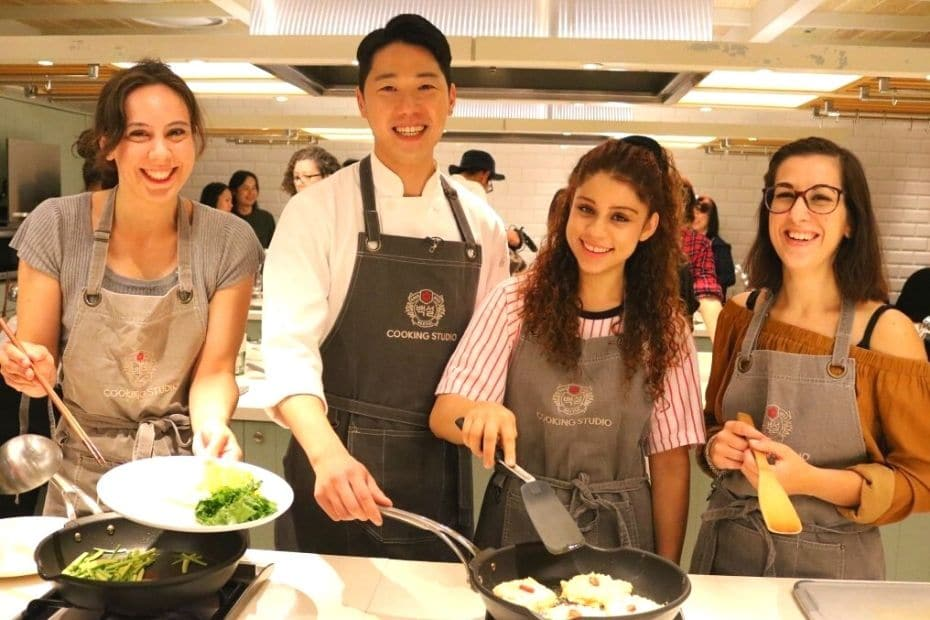 People learning to cook traditional Korean dishes in Seoul