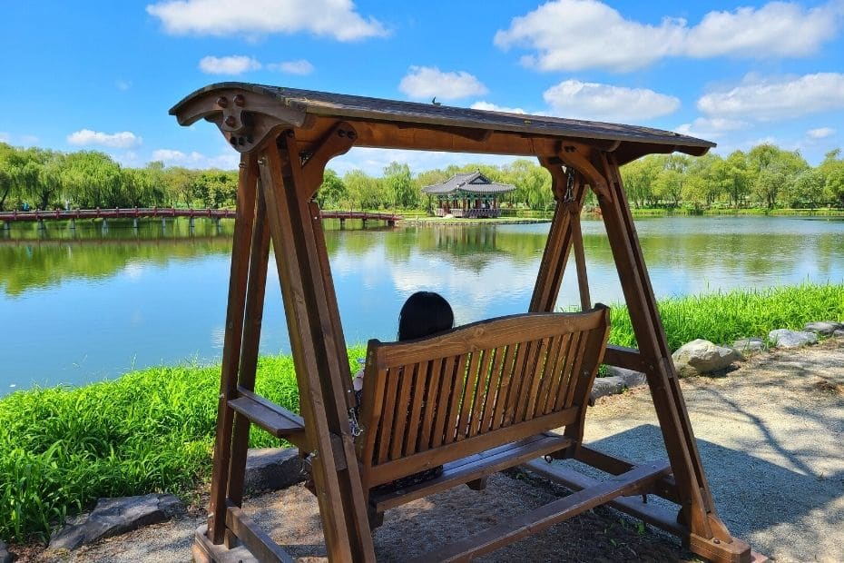 Swinging chair overlooking Gungnamji Pond, Buyeo